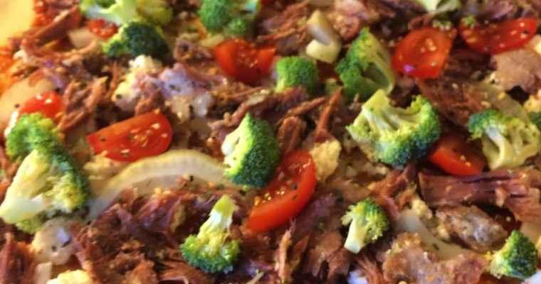 Pizza med konfitert and og broccoli